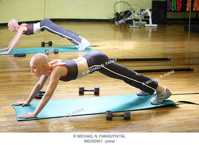 Caucasian woman with cancer/alopecia areata working out