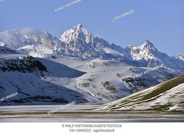 View to snow covered mountains, Grand teton Range over National Elk Refuge in winter, nice winter day, Wyoming, USA