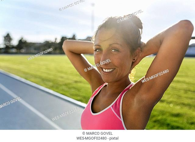 Portrait of athlete stretching in stadium