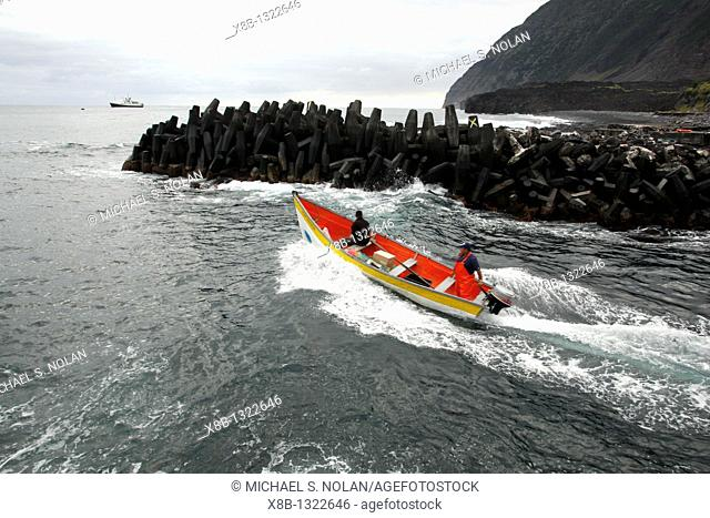Local fisherman departing the breakwall on the island of Tristan da Cunha, claimed to be the most remote inhabited island in the world