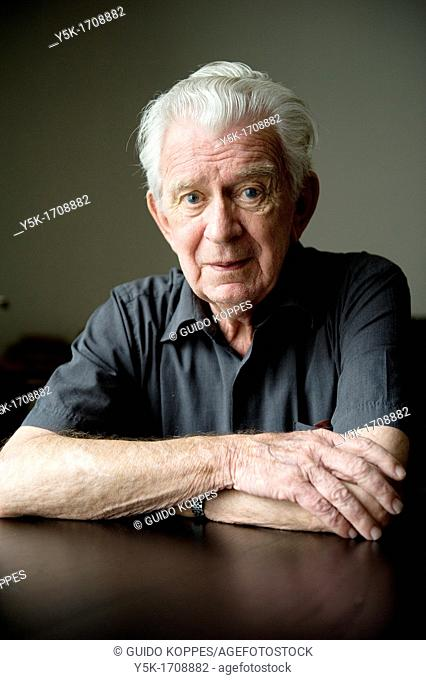 Portrait of an older, Dutch man, sitting at a diner-table