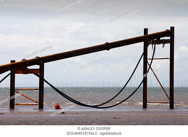 A jack up barge working on the foreshore of the Solway Firth near Workington, installing the power cable that will carry the electricity from the new Robin Rigg...