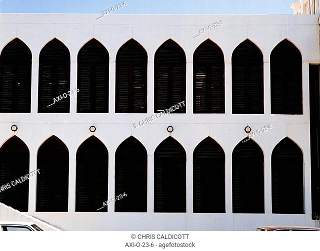 Building exterior with window shutters