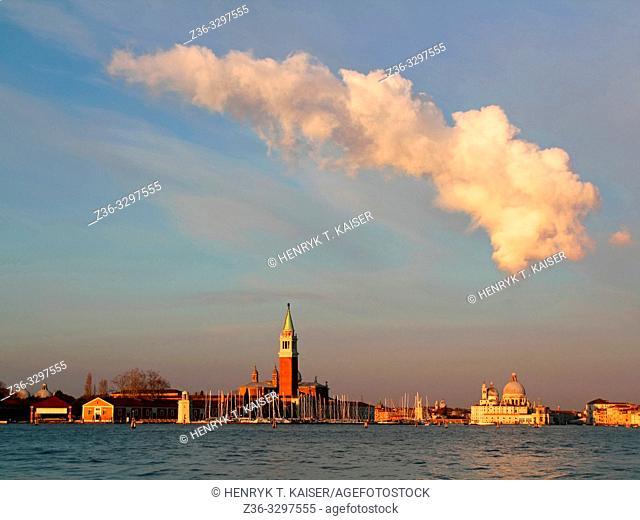 Venice skyline with Santa Maria Della Salute and San Giorgio di Maggiore church in the morning cloud