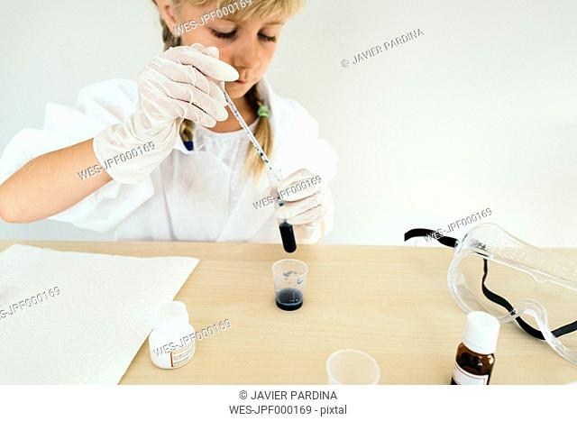 Child playing in chemical laboratory