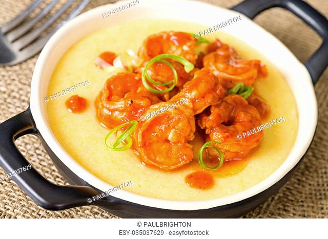 Spicy Prawns & Polenta - Soft polenta topped with prawns in tomato and chili sauce garnished with spring onion
