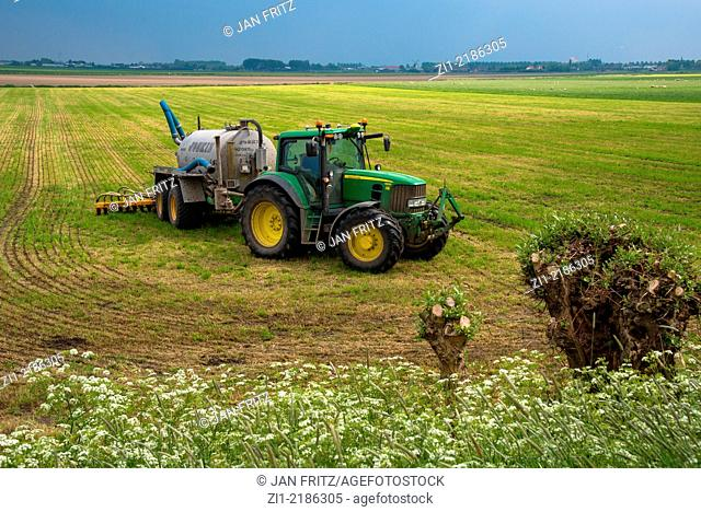 tractor with manure injector at farmland in holland