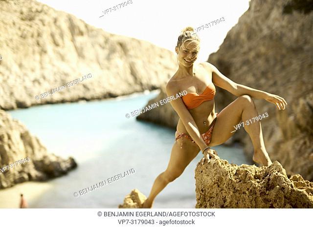 woman on rocks at Seitan Limania Beach, Crete, Greece