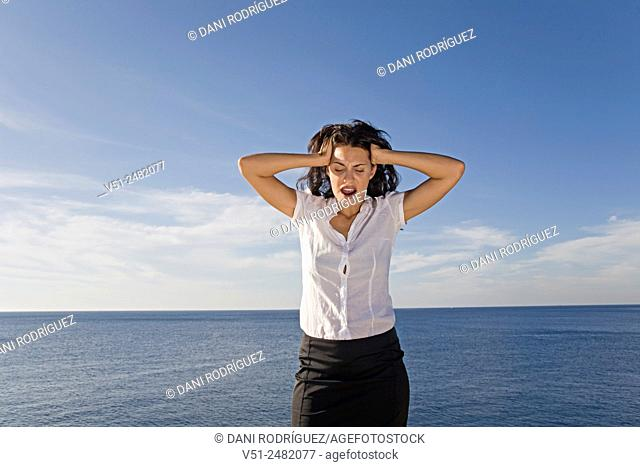 Brunette woman with stress by the sea