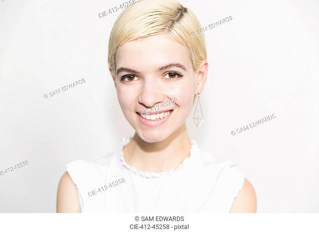 Portrait smiling, confident young woman