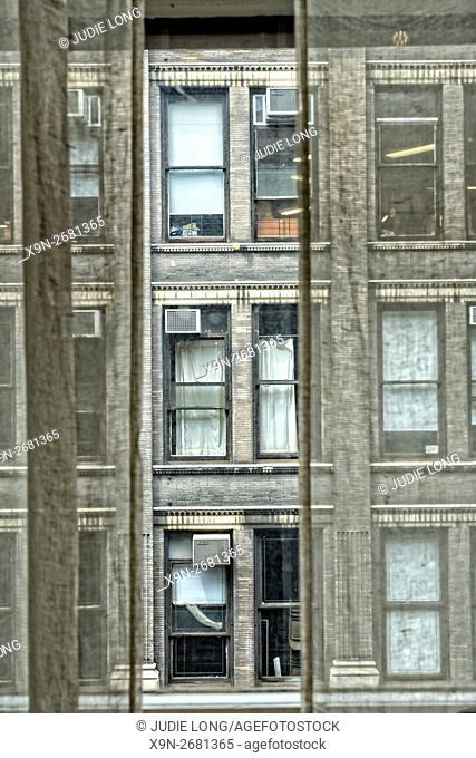 Manhattan, New York City - Looking Through a Sheer Curtain Covered Window in the Flatiron District, at a Cast Iron Building Across the Street