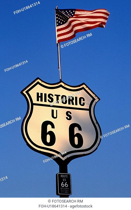 Route 66, road sign, Springfield, U.S. Flag, IL, Illinois, American Flag flies above an Historic Route 66 road sign in Springfield, Illinois