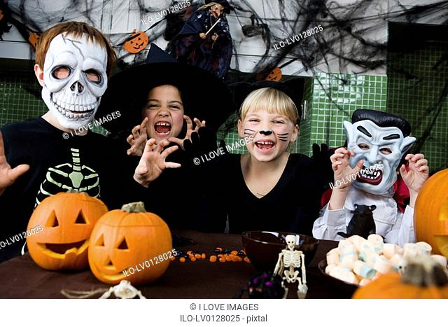 Four friends at a Halloween party