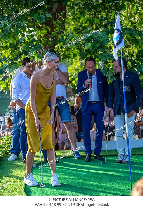 18 June 2019, Bavaria, Munich: Golf: European Tour - International Open - Tee-Off Night in the English Garden to kick off the BMW International Open 2019