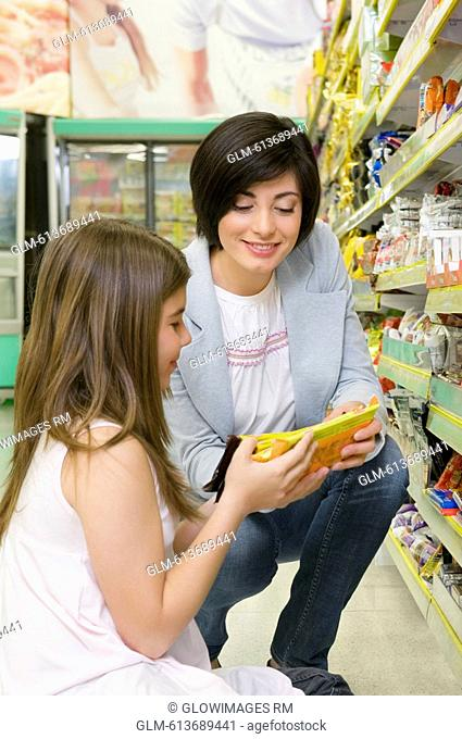 Woman with her sister shopping in a supermarket