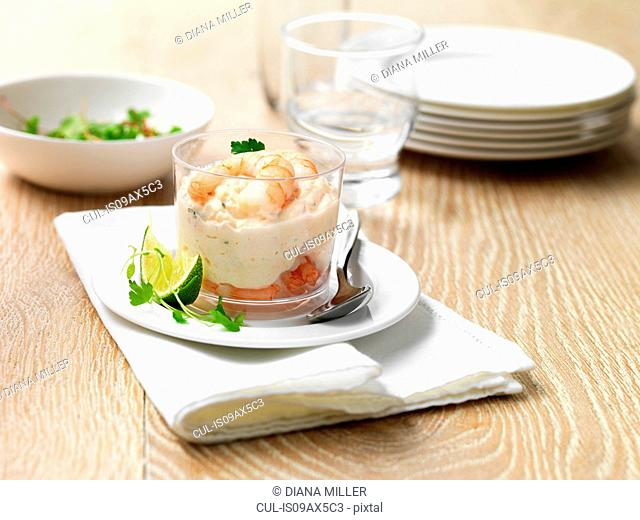 King prawn and salmon starter with lime wedge