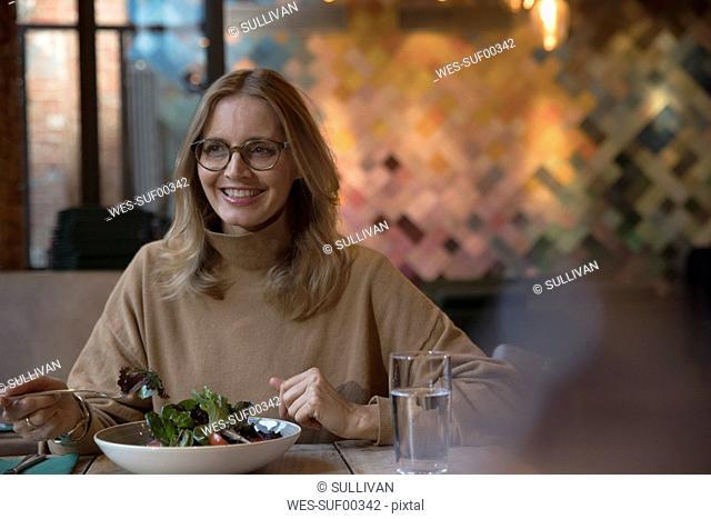 Portrait of businesswoman having lunch in a restaurant