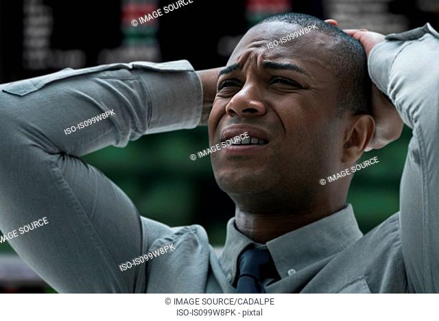 Stressed businessman at stock exchange