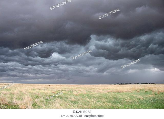 The sky turns dark and turbulent as a storm approaches in the high plains of eastern Colorado