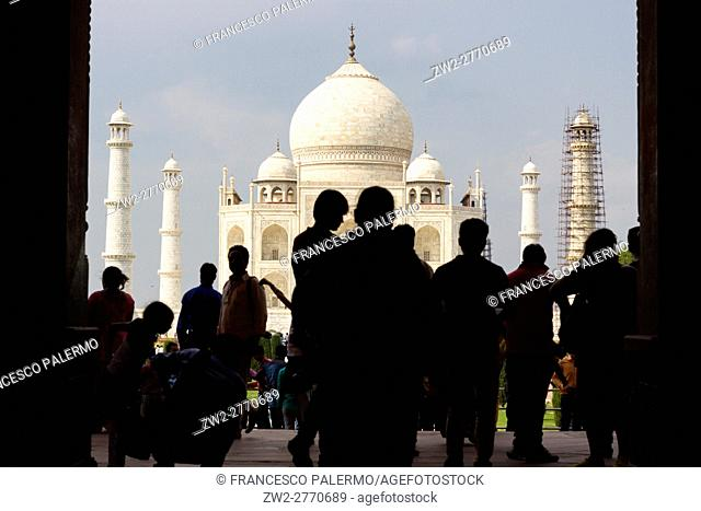 Human silhouettes with Taj Mahal on background. Agra, Uttar Pradesh. India