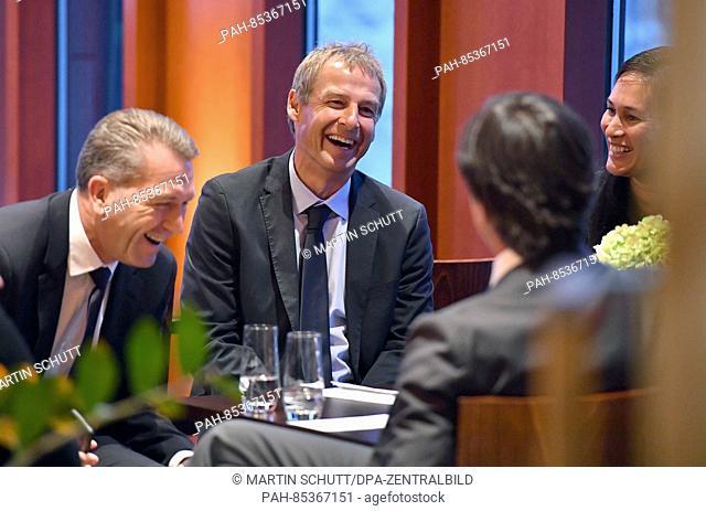 Former coach of the German national soccer team, Juergen Klinsmann(C) speaks with Andreas Koepke, goalkeeping coach of the German national team