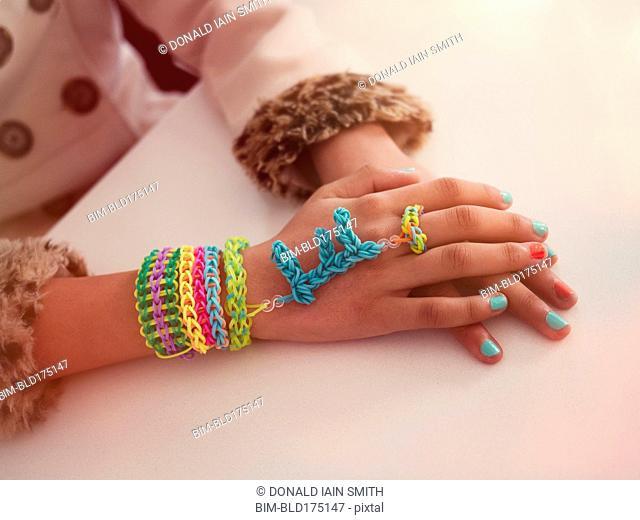 Mixed race girl wearing handmade jewelry