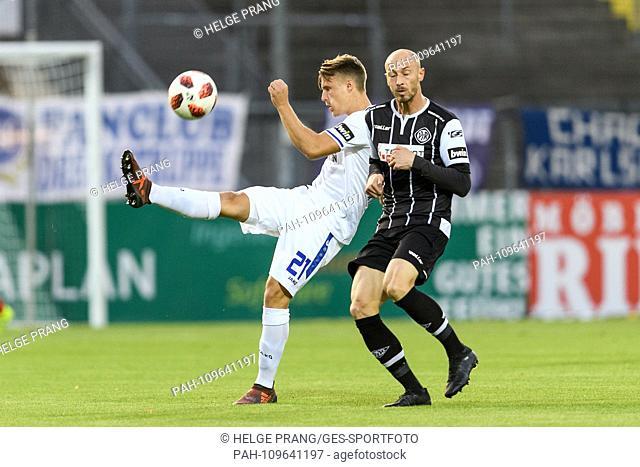 Marco Thiede (KSC) in duels with Matthias Morys (VfR Aalen). GES / Soccer / 3. Liga: VfR Aalen - Karlsruher SC, 26.09.2018 - Football / Soccer 3rd Division: VfR...