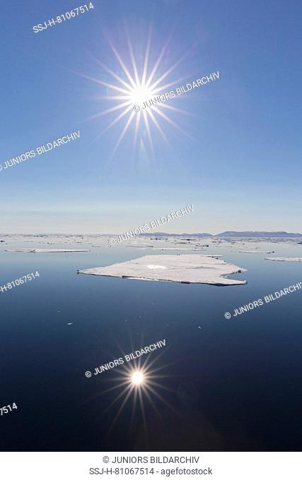 Midnight sun over the Arctic Ocean. Nordaustland, Svalbard, Norway
