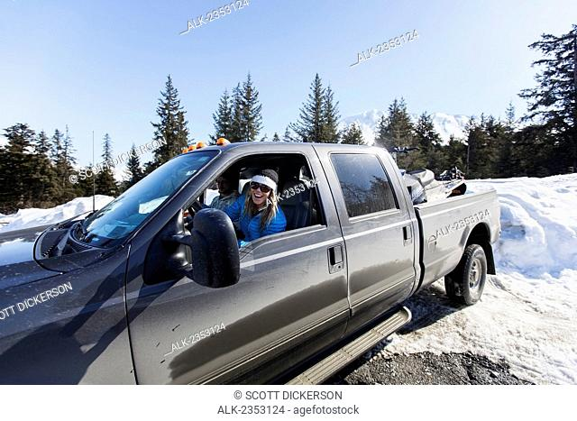 Lynsey Dyer Backing Up Her Ford F-350 To Unload Her Snowmobile For Some Backcountry Skiing, Late Winter, Chugach Mountains, Southcentral Alaska