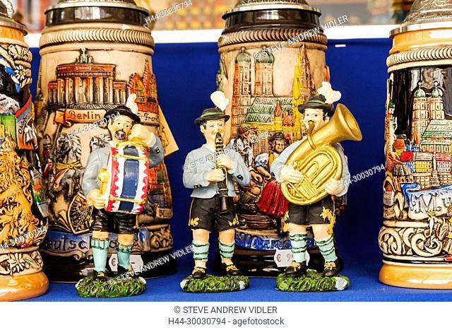 Germany, Bavaria, Munich, Marienplatz, Souvenir Shop Display of Beersteins and Figures Dressed as Bavarian Musicians