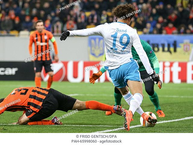 Leroy Sané (R) of Schalke and Ismaily (L) of Donetsk vie for the ball during the UEFA Europa League Round of 32 first leg soccer match between Shakhtar Donetsk...