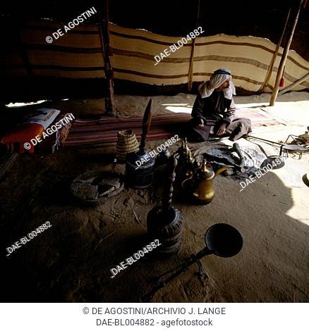 Man in a Bedouin tent in the Judean Desert, Israel
