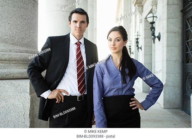 Caucasian business people standing outdoors