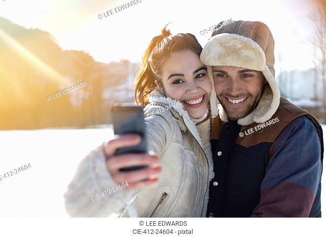 Couple taking selfie in snow