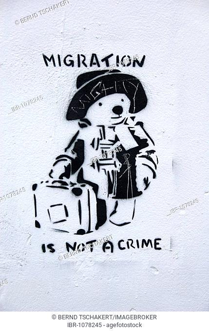 Paddington Bear, graffiti, slogan, Migration is not a Crime, Bristol, England, Great Britain, Europe