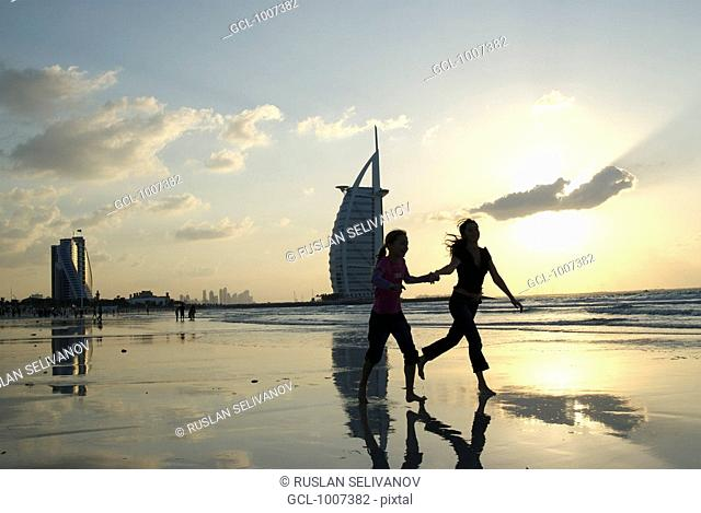 Mother and daughter on the beach in Dubai, UAE