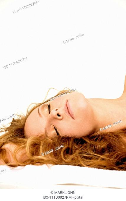 Blonde woman lying on towel