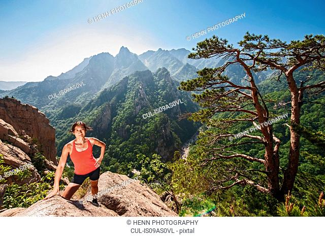 Female hiker climbing up a ridge at Seoraksan National park, Gangwon, South Korea