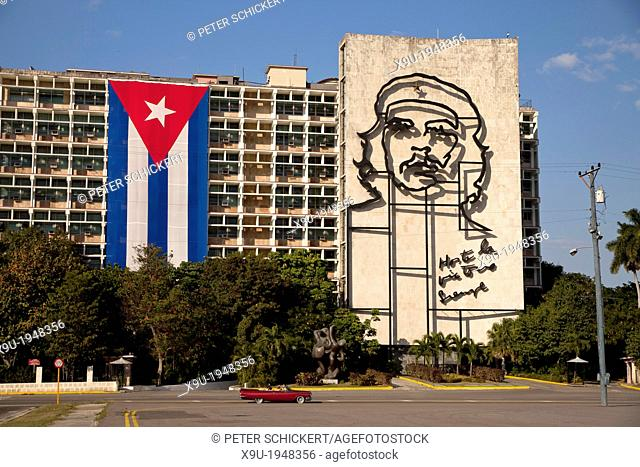 Ministry of Interior building with Che Guevara mural and Cuban flag on Revolution Square ''Plaza de la Revolucion'' with the giant Obelisk Memorial Jose Marti...