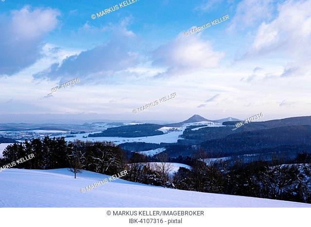 Winter landscape in Hegau, on the horizon of the Hegau volcano Hohenhewen, Konstanz, Baden-Württemberg, Germany