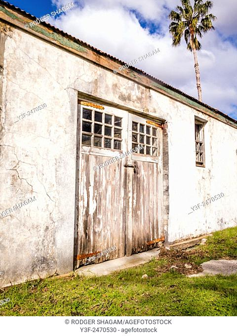 Old barn doors badly in need of a coat of paint and a some fixing. Cape Town, South Africa