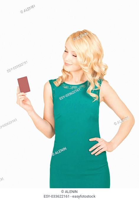 beautiful blonde in a green dress holds a card