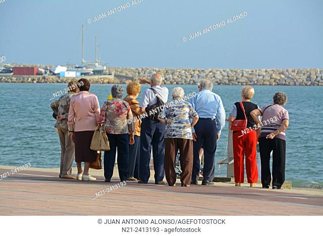 Senior citizens on an excursion to the coastal town of Cambrils, Tarragona, Catalonia, Spain, Europe