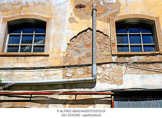 windows and drain, industrial area, plaza del Nou, Zona Franca, Barcelona, Catalonia, Spain