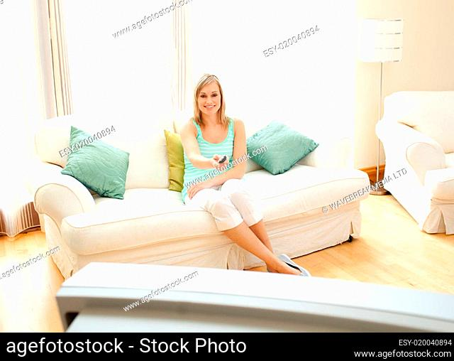 Happy Caucasian woman watching TV