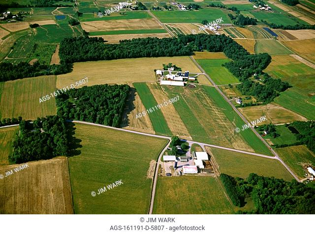 Agriculture - Aerial view of dairy farmsteads surrounded by agricultural fields / OH - nr. Salem