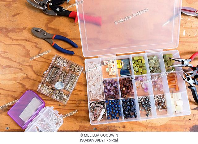 Jewellery makers tools on workbench, overhead view
