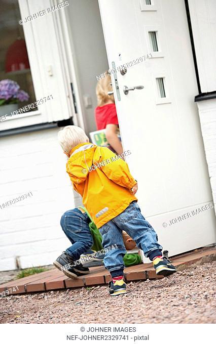 Children entering house