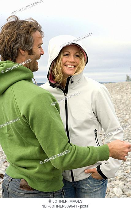 A laughing couple on a beach