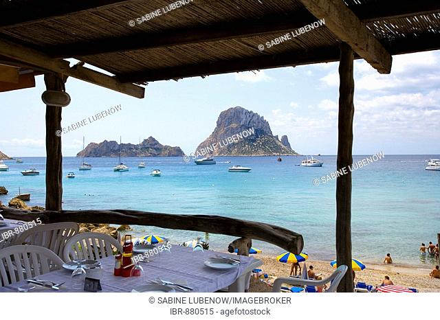 Beach restaurant in the bay of Cala d'Hort, view of rock island Es Vedra, Ibiza, Balearic Islands, Spain, Europe
